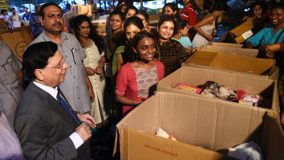 CJI Dipak Mishra inspects the relief material collected for Kerala flood victims and meets the volunteering lawyers outside Supreme Court on August 22, 2018 in New Delhi. (Vipin Kumar / HT  Photo)