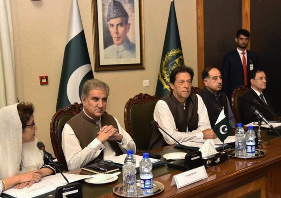 Pakistan's Prime Minister Imran Khan (centre) attends a briefing at the foreign ministry in Islamabad, Pakistan, August 24, 2018