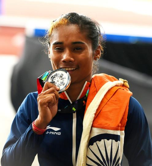 Indian athlete Hima Das celebrates after securing silver medal in the women's 400m final on Athletics track event at the 18th Asian Games 2018. (PTI)