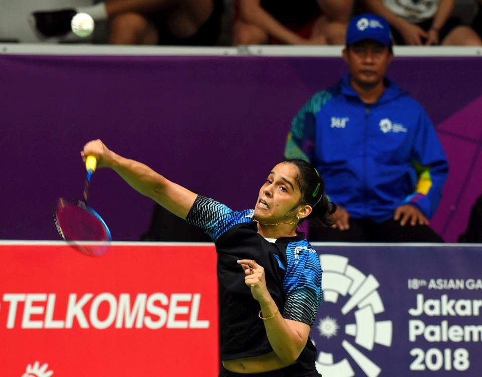 Indian shuttler Saina Nehwal in action against Thailand's R Intanon during women's singles quarter final badminton match. (PTI)