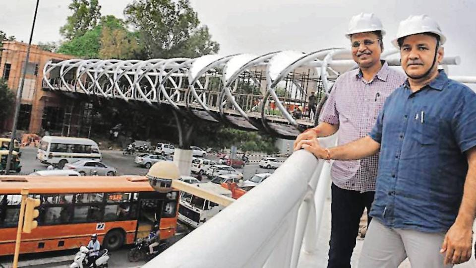 PWD minister Satyendra Jain and deputy CM Manish Sisodia inspect the skywalk.