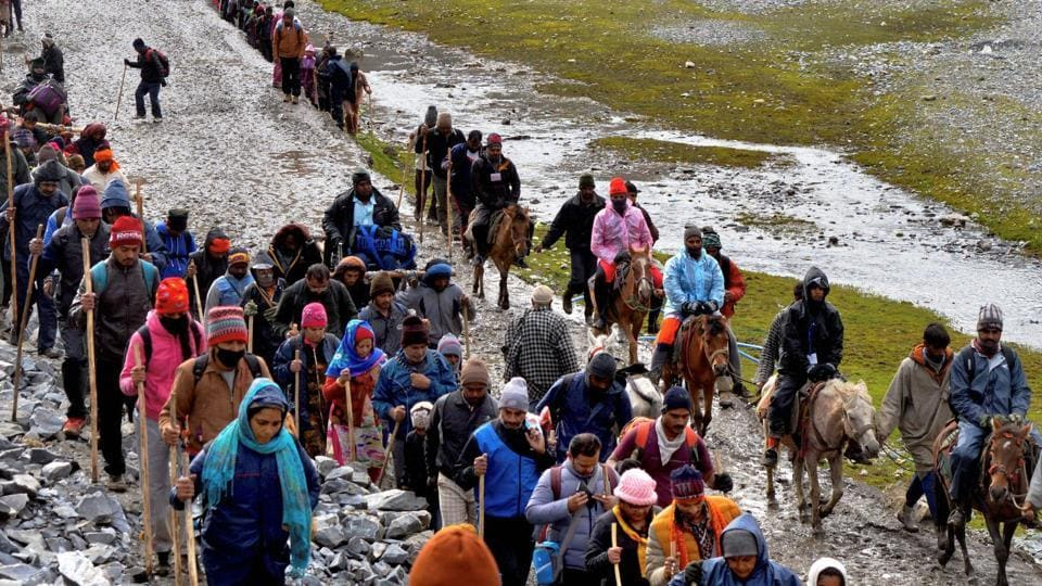Pilgrims cross mountain trails during their religious journey to the Amarnath cave temple, at Pahalgam in Anantnag district of Jammu and Kashmir.