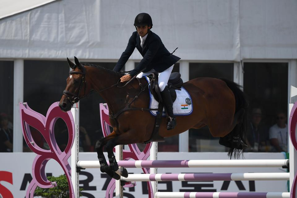 India's Fouaad Mirza competes in the eventing team and individual jumping event at the equestrian competition. (AFP)