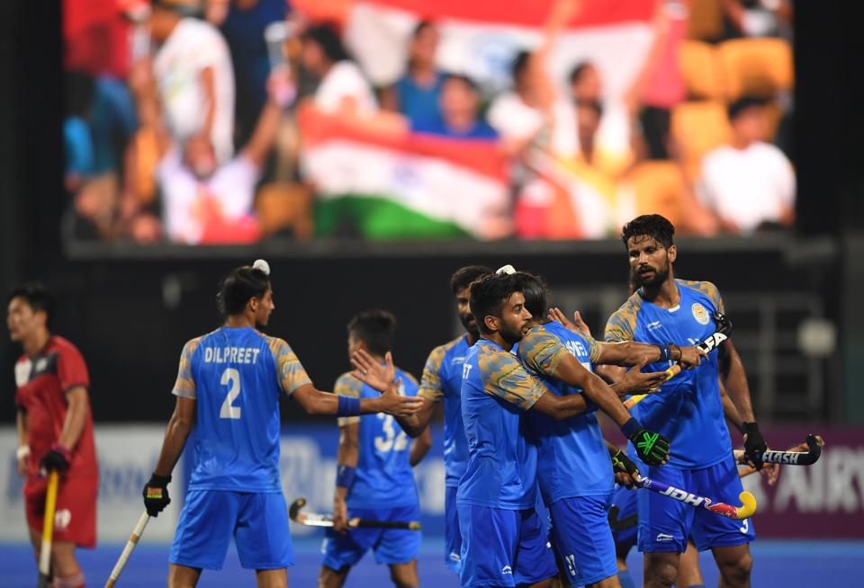 India's players celebrate after scoring a goal against South Korea during the men's hockey pool A match between India and South Korea. (AFP)