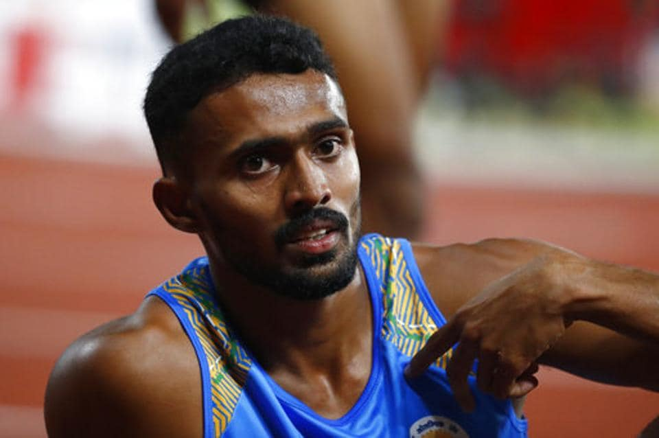 India's Muhammed Anas Yahiya reacts after his second place finish in the men's 400m final during the athletics competition. (AP)