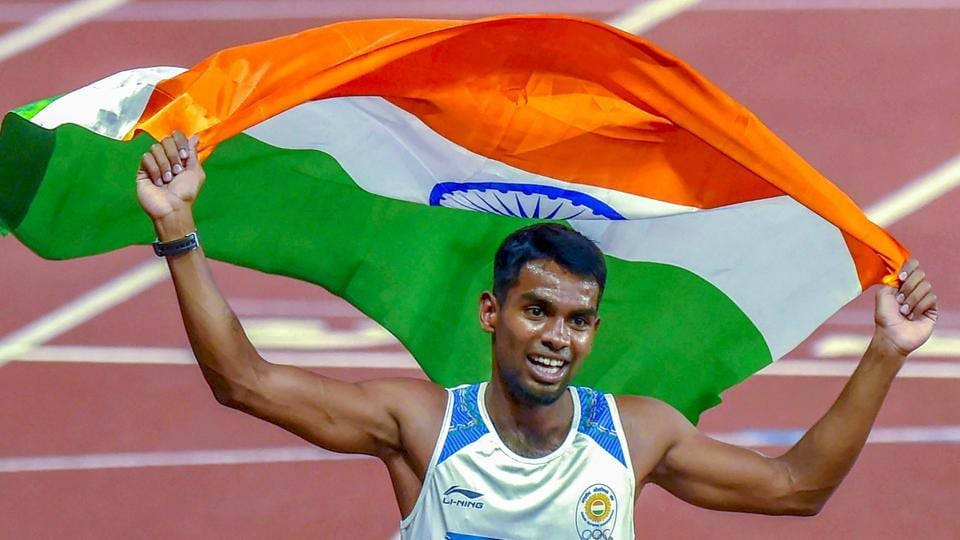 Jakarta: India's Ayyasamy Dharun celebrates with a Tricolour after winning the Silver medal in the men's 400m hurdles event at the 18th Asian Games 2018 in Jakarta, Indonesia on Monday, Aug 27, 2018.