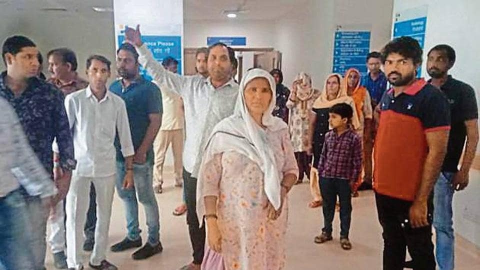 The kin of Vinod Bhati, who was attacked on Saturday night by four unidentified men, waiting outside the ICU where is admitted.
