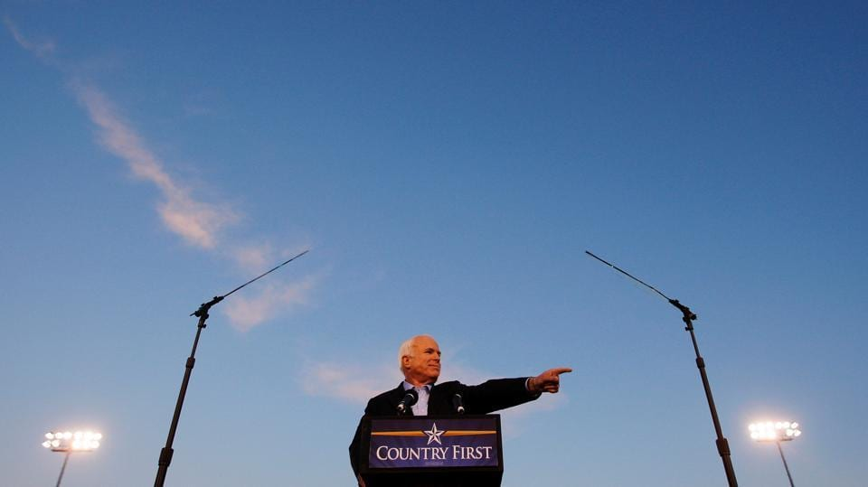 John McCain speaks at a campaign rally in Durango, Colorado on October 24, 2008. In Congress, McCain prided himself on his history of working across party lines on immigration, climate change and campaign finance reform. He supported the 2003 invasion of Iraq but also spoke out against the administration's use of waterboarding, and other extreme interrogation tactics in the aftermath of the 9/11 attacks. (Brian Snyder / REUTERS File)