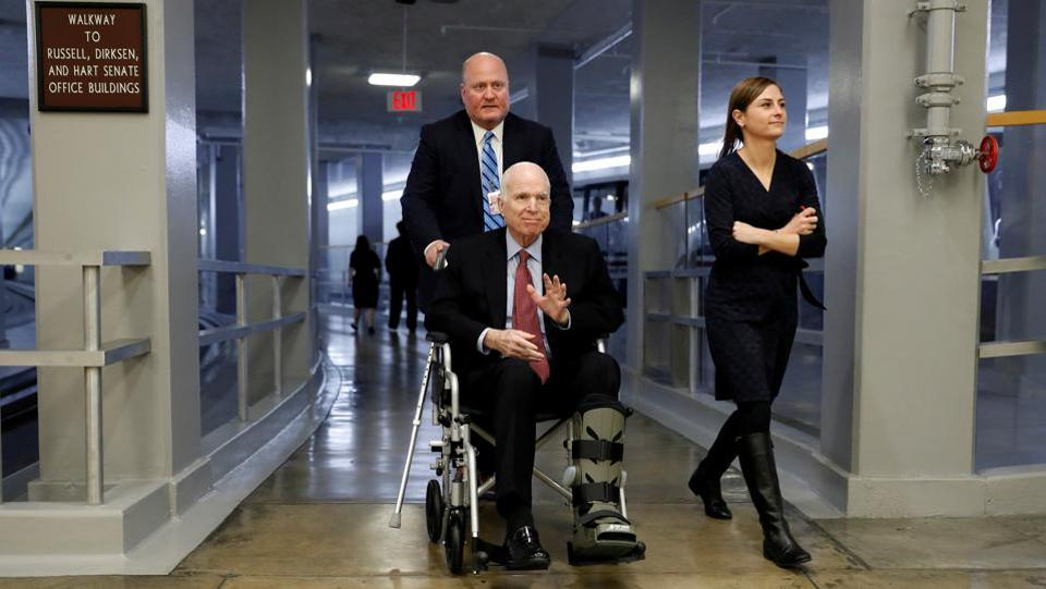 Senator John McCain heads to the Senate floor ahead of votes on Capitol Hill in Washington on December 6, 2017. He was the central figure in one of the most dramatic congressional moments in Trump's presidency when he returned to Washington shortly after his brain cancer diagnosis for a middle-of-the-night vote in July 2017. (Aaron P. Bernstein / REUTERS File)