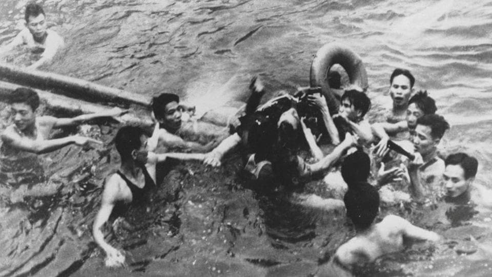 An October 26, 1967 photo shows John McCain pulled out of a Hanoi lake by a mix of North Vietnamese Army (NVA) and Vietnamese citizens. In October 1967, his A-4 Skyhawk was shot down on a bombing mission over North Vietnam's capital and he suffered two broken arms and a broken leg. A mob dragged him from a lake, broke his shoulder and stabbed him. (REUTERS File)