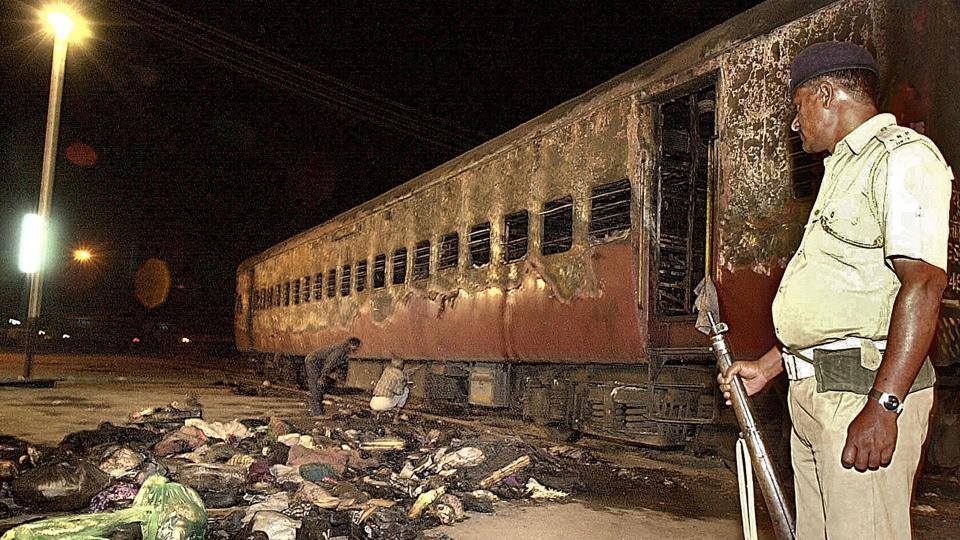 Two men accused in the torching of the Sabarmati Express train in Godhra, Gujarat, in February 2002 will serve life in prison, said a special court in Ahmedabad on Monday. Judge H C Vora convicted Farooq Bhana and Imran Sheru after the prosecution proved they were conspirators in the burning of two coaches that led to the death of 59 passengers. (Sebastian D'Souza / AFP File)