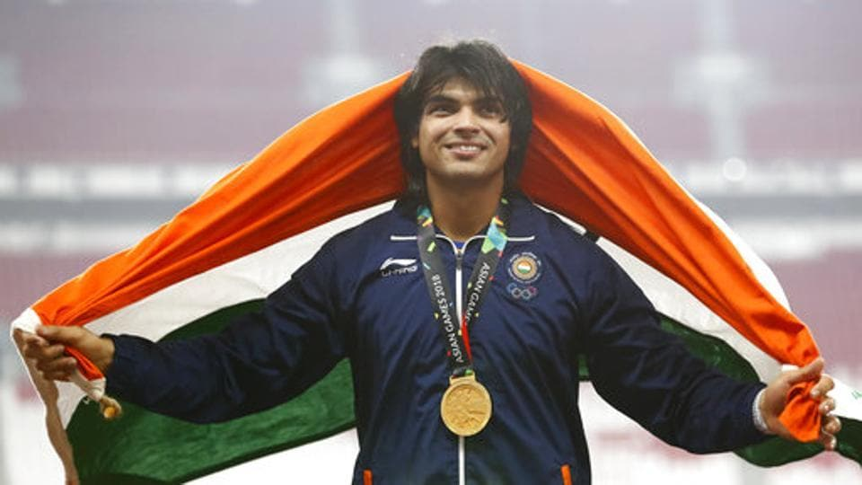 Men's javelin gold medallist India's Neeraj Chopra smiles as he stands on the podium during the athletics competition at the 18th Asian Games. (AP)