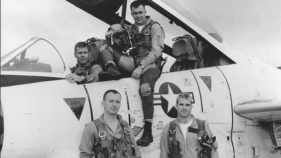 John McCain (Bottom R) poses with his US Navy squadron in 1965. McCain flew attack planes off aircraft carriers during the Vietnam War. A senator from Arizona for more than three decades, McCain had been suffering from brain cancer since July 2017. (US National Archives via REUTERS)