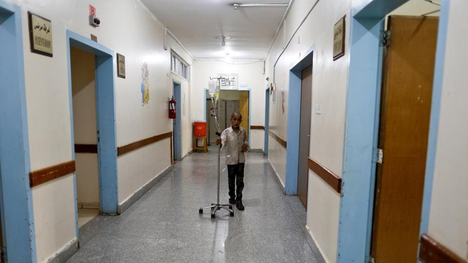 A boy who has cancer walks with an intravenous drip at The National Oncology Centre. The WHO said that prior to the conflict, the centre used to receive $15 million a year from the state and that the budget was used to purchase chemotherapy medications and anti-cancer drugs for oncology centres across the country. (Khaled Abdullah / REUTERS)