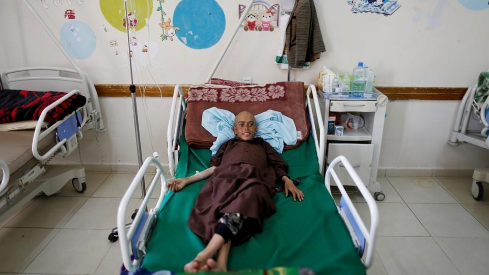 The few beds available at the centre are reserved for children. Other patients receive treatment intravenously, while sitting on dilapidated recliner chairs or in the waiting area. (Khaled Abdullah / REUTERS)