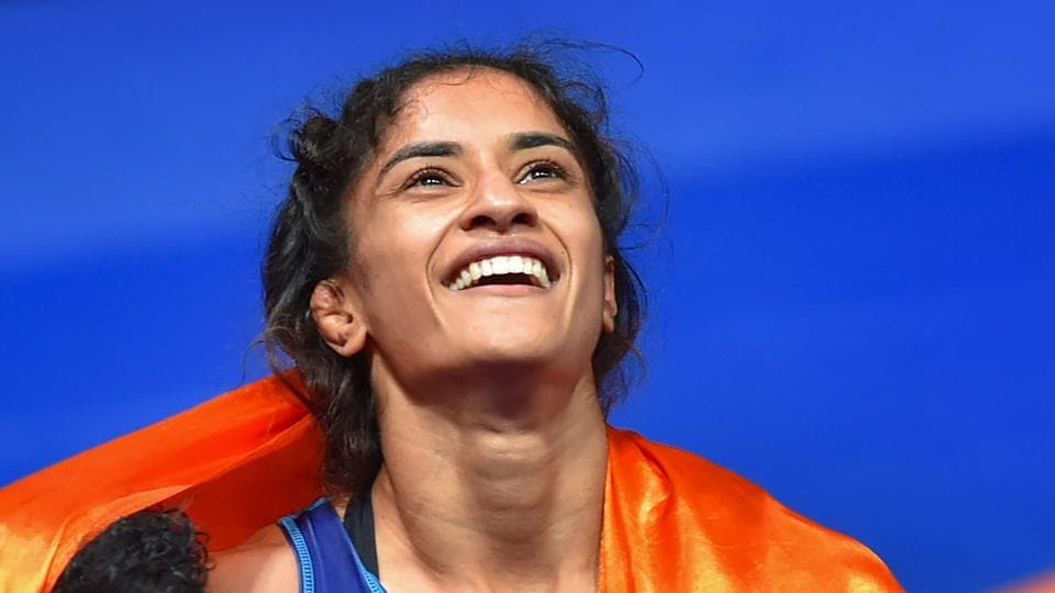 Jakarta: India's Vinesh Phogat celebrates after winning the Gold medal in women's freestyle 50 kg wrestling at the Asian Games 2018, in Jakarta on Monday, August 20, 2018. Phogat made history after she became the first Indian woman to win a gold at Asian Games. She beat Japan's Irie Yukie 6-2 in the finals.