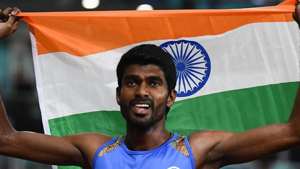 India's Jinson Johnson celebrates after the final of the men's 800m athletics event during the 2018 Asian Games. (AFP)
