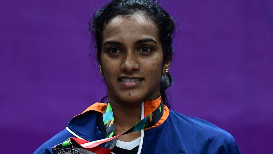Silver medallist India's V. Sindhu Pusarla poses with her medal during the awards ceremony for the women's singles badminton. (AFP)