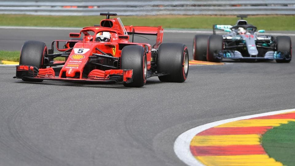 Ferrari's German driver Sebastian Vettel competes ahead of Mercedes' British driver Lewis Hamilton during the Belgian Formula One Grand Prix at the Spa-Francorchamps circuit in Spa on August 26, 2018.