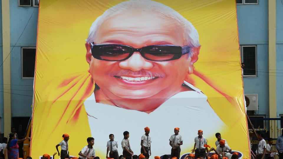 School students in Chennai gather under a potrait of MKarunanidhi to pay homage.