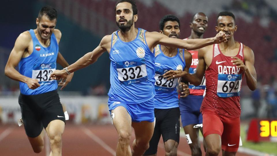 India's Manjit Singh reacts as he crosses the finish line to win the men's 800m final during the athletics competition at the 18th Asian Games. (AP)