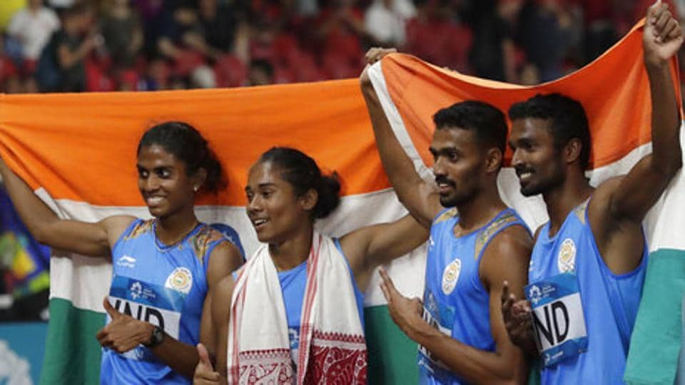 India's 4x400m mixed relay team celebrate after winning the silver medal during the athletics competition at the 18th Asian Games. (AP)