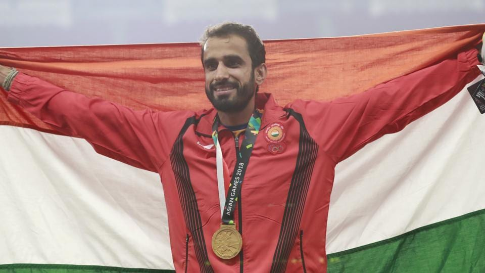 Men's 800m gold medalist India's Manjit Singh stands on the podium during the athletics competition at the 18th Asian Games. (AP)