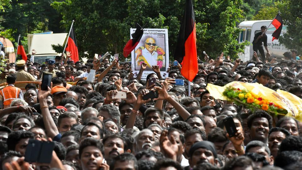 Supporters arrive to pay their last respects to DMK chief M Karunanidhi at Rajaji Hall in Chennai.