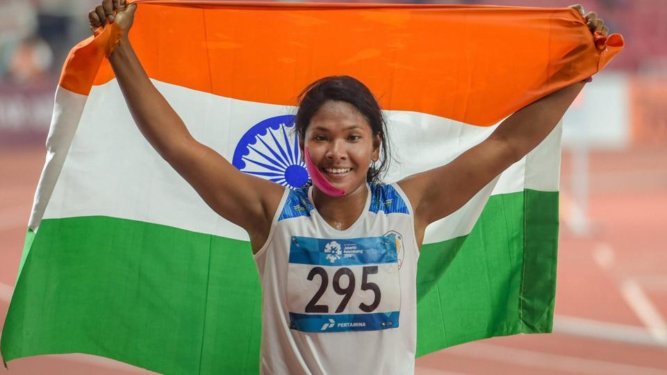 Jakarta: Indian athlete Swapna Barman celebrates after winning the gold medal in the women's Heptathlon event at the 18th Asian Games. (PTI)