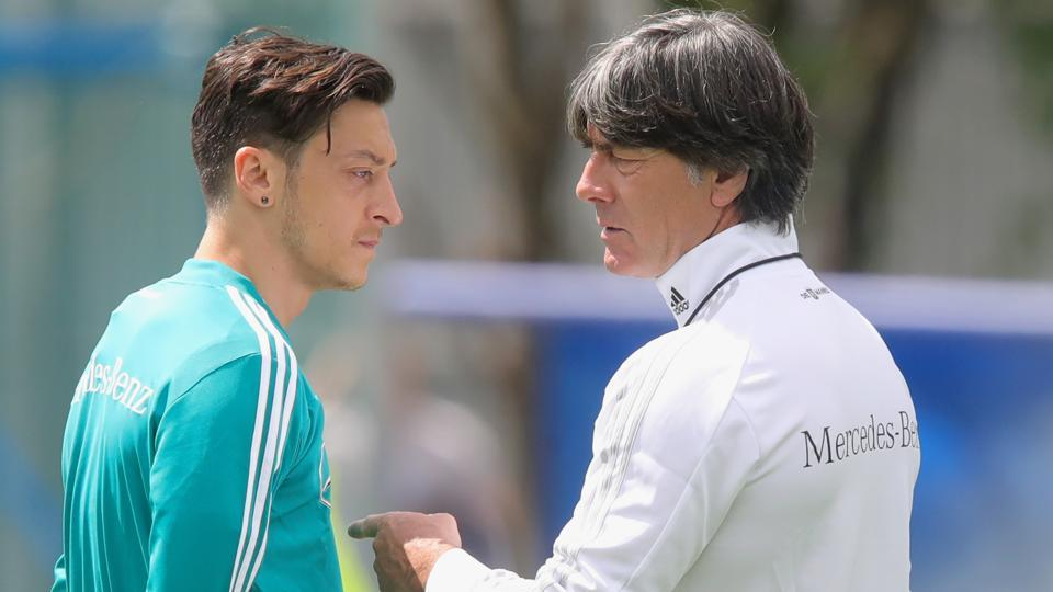 Joachim Loew, head coach of Germany talks to his palyer Mesut Oezil during the Germany training session ahead of the 2018 FIFA World Cup at CSKA Sports Base on June 13, 2018 in Moscow, Russia.