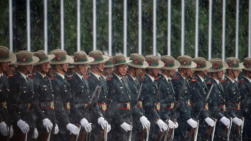 Nepalese Army personnel wait in the rain to present the guard of honour to Sri Lanka's President Maithripala Sirisena before his arrival to attend the Bay of Bengal Initiative for Multi-Sectoral Technical and Economic Cooperation (BIMSTEC) summit in Kathmandu, on Wednesday.