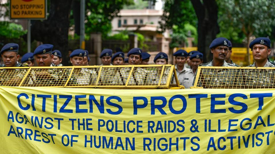 Delhi Police personnel stand on duty as activists from various organisations stage a protest pertaining to the arrest of five activists, in connection with the Bhima-Koregaon protests, in New Delhi on Wednesday, Aug 29, 2018.