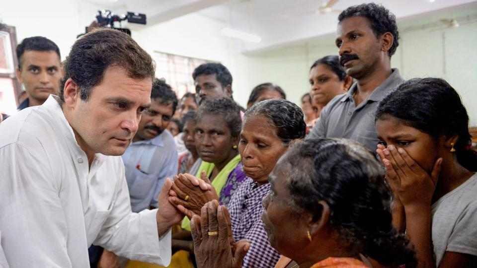 Congress president Rahul Gandhi interacts with the flood-affected people at a relief camp in Chengannur, Alapuzha, Kerala on August 28.