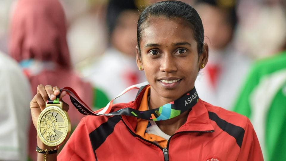 Bronze medallist athlete Chitra poses for photographs at the medal ceremony of women's 1500m event. (PTI)