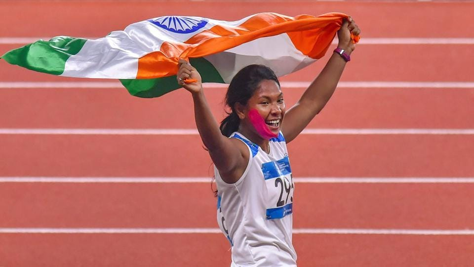 Indian athlete Swapna Barman celebrates after winning the gold medal in the women's Heptathlon event at the 18th Asian Games, in Jakarta, Indonesia on Wednesday, Aug 29, 2018.