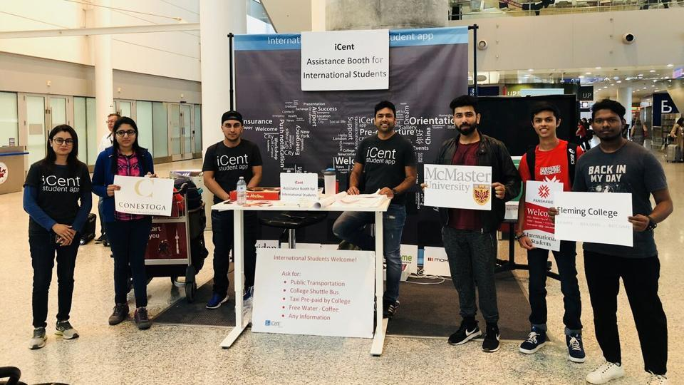 The iCent booth at Toronto's Pearson Aiport. The startup's founder Ganesh Neelanjanmath is seen seated in the middle.