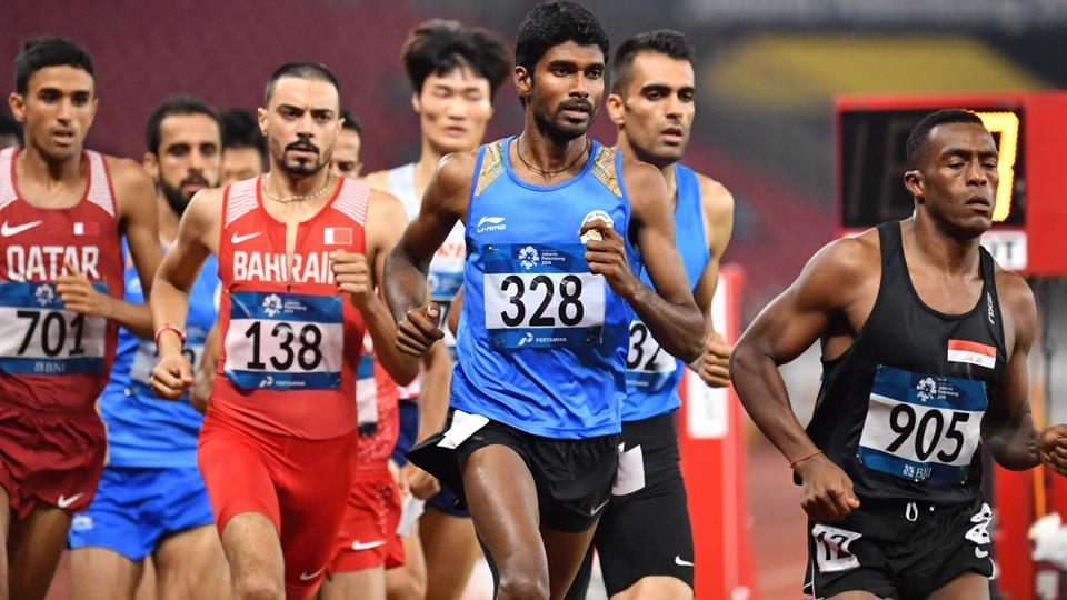 India's Jinson Johnson (C) competes in the final of the men's 1500m athletics. (AFP)