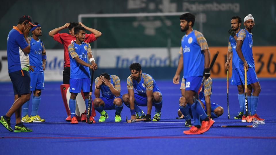 India's players react after losing to Malaysia in the men's field hockey semi-final match. (AFP)