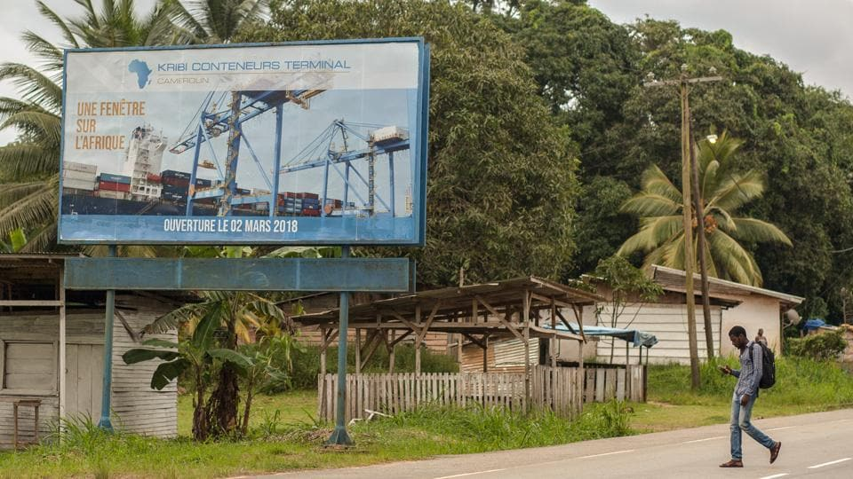 A billboard advertising Kribi Container Terminal stands at the roadside. The official opening of the port's first container and multi-purpose terminals in March was a bright spot for Cameroon's government, which is facing insurgencies, widespread discontent with President Paul Biya's 35-year grip on power and a steep drop in oil income. (Adrienne Surprenant / Bloomberg)