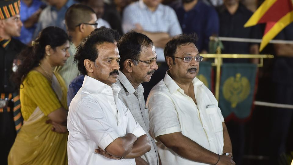 DMK chief MK Stalin (left) with family members MK Alagiri (right), Kanimozhi and others.