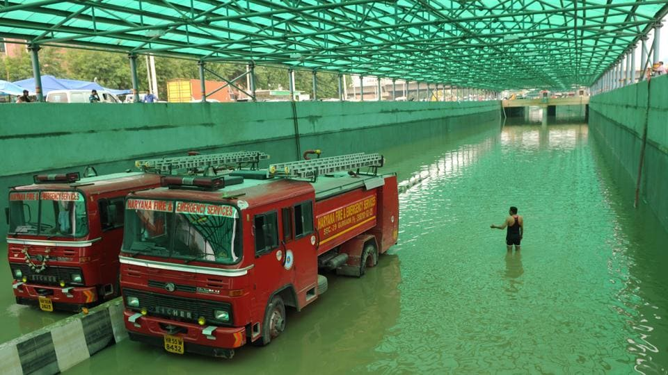 Waterlogged Hero Honda Chowk underpass is being drained by fire brigade tenders after heavy rains on Tuesday inundated the area in Gurugram on Wednesday.