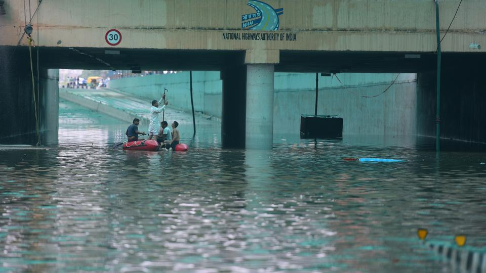 A day after Gurugram received its highest rainfall in a day in the last eight years, the underpass at Hero Honda Chowk remained flooded. Officials of the National Highways Authority of India estimate that 50 million litres of water had accumulated at the underpass following backflow from the stormwater drain at Badshahpur on Tuesday. Officials pressed into service eight fire engines, eight heavy duty pumps, tractor-trolleys and other equipment. (Sanjeev Verma / HT Photo)