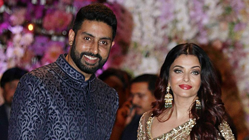 Bollywood actors Abhishek Bachchan (L) and Aishwarya Rai Bachchan pose for a picture at the pre-engagement party of India's richest man and Reliance Industries Limited Chairman, Mukesh Ambani's eldest son Akash Ambani and fiancee Shloka Mehta.