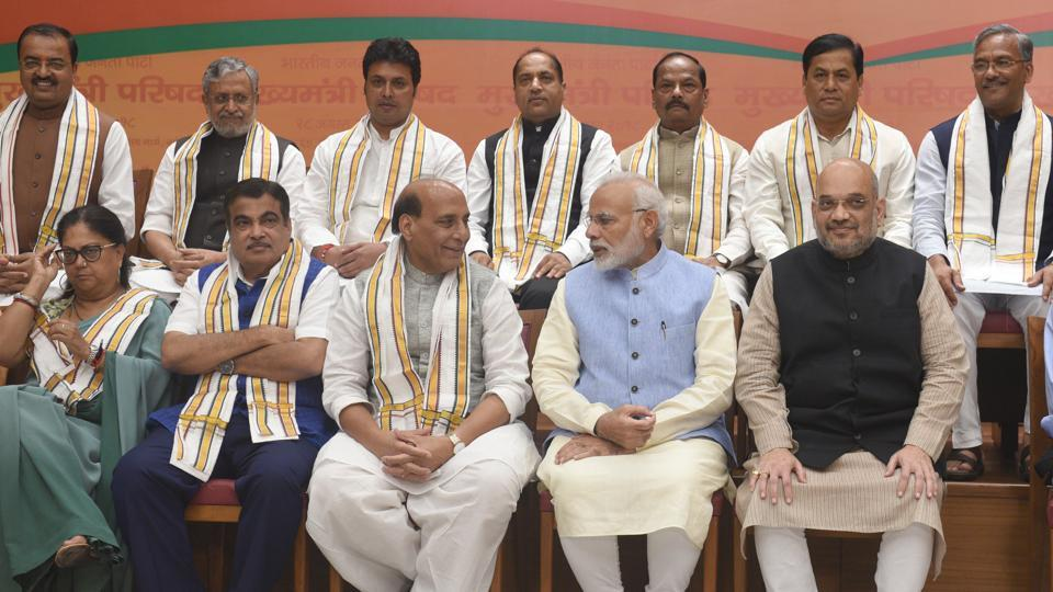 Prime Minister Narendra Modi, Union minister of home affairs Rajnath Singh and BJP national president Amit Shah during the BJP chief ministers' council meeting in New Delhi, August 28