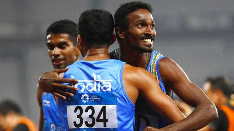 India's men's 4x400m relay team celebrate after their second place finish during the athletics competition. (AP)