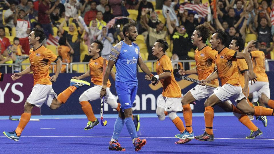 Malaysia's team jubilate after winning against India during their men's hockey semi-final match. (AP)