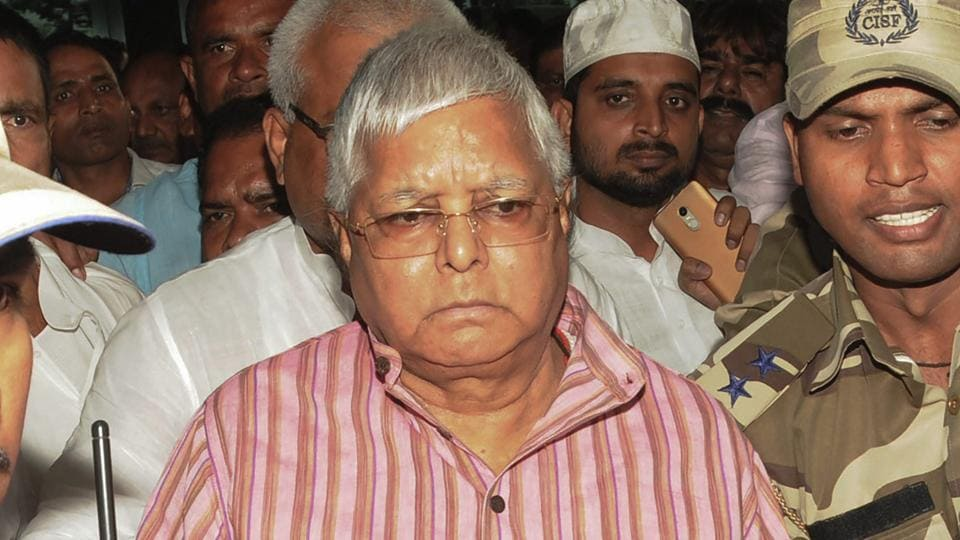 RJD leader Lalu Prasad arrives at the airport to surrender at the CBI court in connection with multi-crore fodder scam case, in Ranchi.