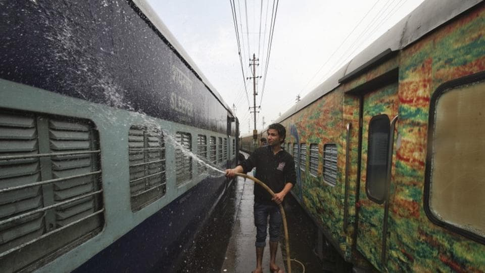 A worker cleans a stationed train at a railway station in Jammu February 26, 2015.