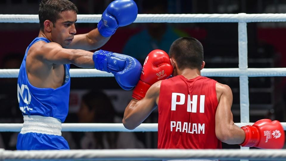 India's Amit Panghal (in blue) in action against Paalam Carlo of Philippines during the Men's Light Fly (46-49kg) boxing semifinal bout. (PTI)