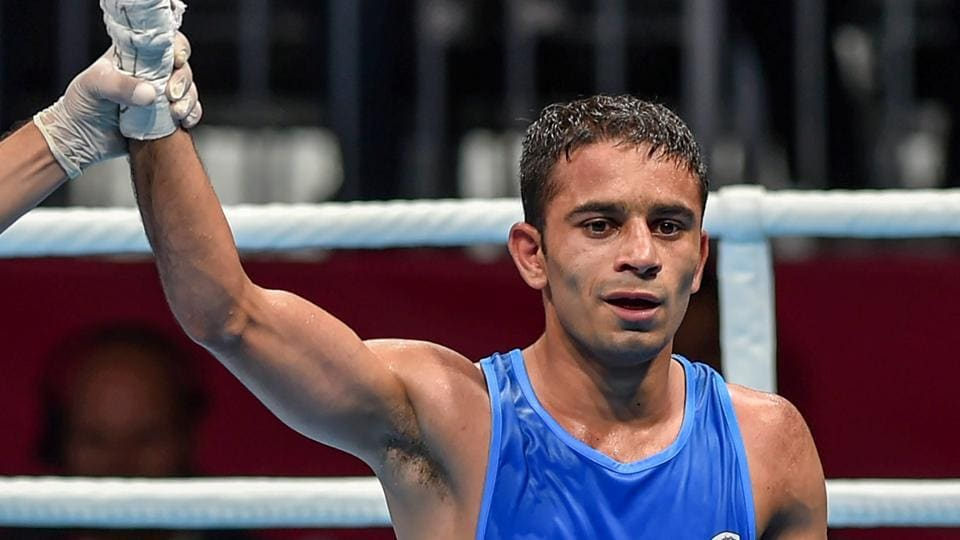 India's Amit Panghal (in blue) is declared winner against Paalam Carlo (unseen) of Philippines in the Men's Light Fly (46-49kg) boxing semifinal bout at the 18th Asian Games 2018 in Jakarta, Indonesia on Friday. (PTI)